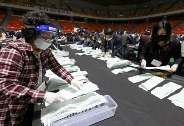 Election Officials Count Votes in Masks, Gloves, Even Face Shields