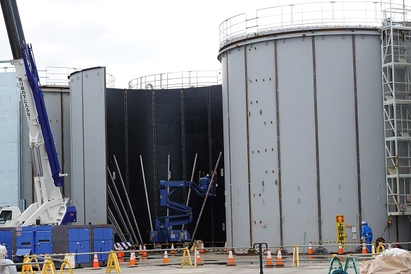 Seen in this photo provided by Japan's Nuclear Safety Research Association on Nov. 18, 2019, is the construction of new water storage tanks at Fukushima No. 1 Nuclear Power Plant.