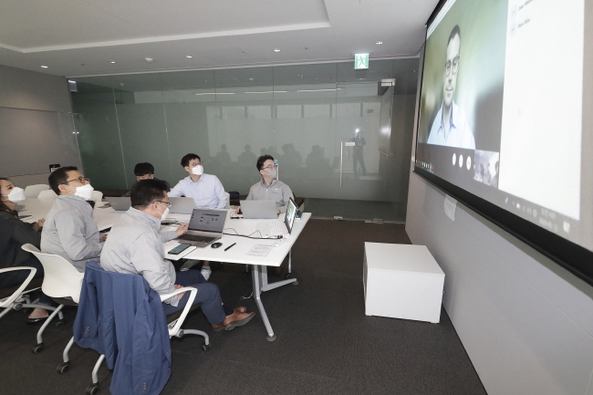 This photo provided by KT Corp. on May 17, 2020, shows the company's officials in Seoul holding a videoconference with an official from the Bill & Melinda Gates Foundation.