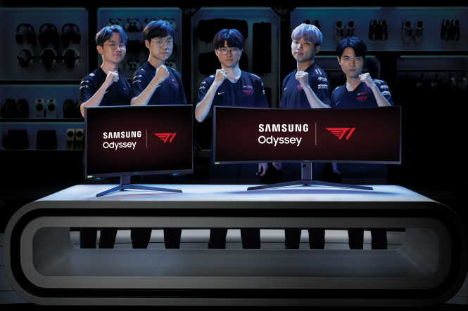 """In this photo provided by Samsung Electronics Co. on May 27, 2020, T1's """"League of Legends"""" team poses for a photo with Samsung's Odyssey curved gaming monitors."""