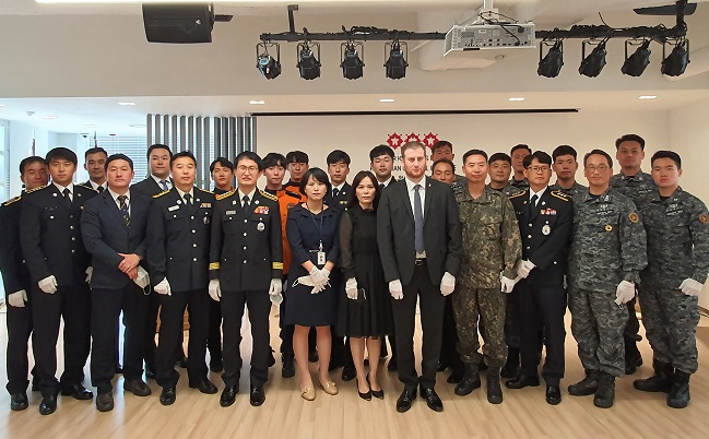 Rescue officials pose for a photo during an award ceremony at the Hungarian Embassy in Seoul, at which they were awarded medals of merit by the Hungarian government, in this photo provided by the Hungarian embassy on May 29, 2020.