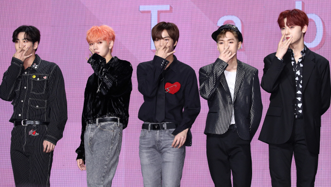 "This file photo from Oct. 21, 2019, shows South Korean boy group NU'EST posing for photos during a showcase for the group's seventh EP ""The Table"" in Seoul. (Yonhap)"