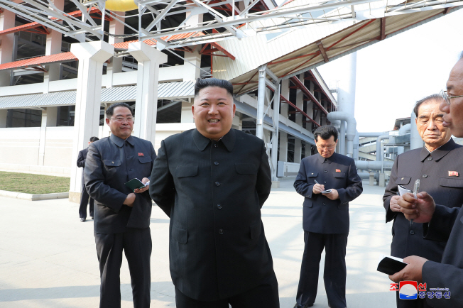 North Korean leader Kim Jong-un (C) attends a ceremony to mark the completion of a phosphatic fertilizer factory in Sunchon, north of Pyongyang, on May 1, 2020, in this photo released the next day by North Korea's official Korean Central News Agency.