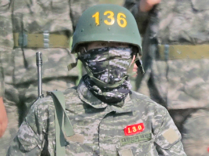 Tottenham Hotspur forward Son Heung-min, wearing a bulletproof helmet (136), returns to a boot camp after finishing a rifle drill at a Marine Corps firing range in Seogwipo on the country's southern Jeju Island on May 6, 2020. (Yonhap)