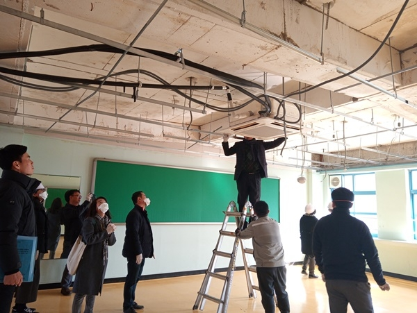 Officials work to remove asbestos from a classroom at a school in the southern city of Gwangju on Feb. 27, 2020, in this photo provided by the Gwangju Metropolitan Office of Education.