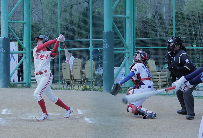 This 2019 file photo provided by Brion Company shows South Korean Park Min-seo taking a swing in a Little League game.