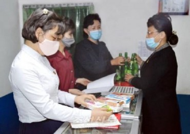 N. Korea's Eye-catching Recycling Incentive: Exchange Empty Bottles for New Shoes