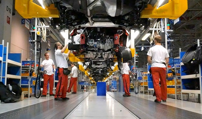 This undated photo provided by Kia Motors Corp. shows workers at the company's plant in Zilina, Slovakia.