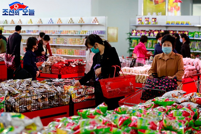 North Korean customers wearing masks shop at the Pyongyang Department Store amid the coronavirus pandemic, in this undated photo taken from North Korea's propaganda website DPRK Today on May 29, 2020.