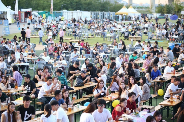 This file photo provided by the organizing committee of the Songdo Beer Festival shows the 2019 festival under way in Incheon, west of Seoul.