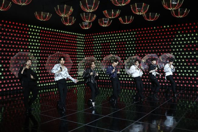 """This image provided by Big Hit Entertainment shows BTS members perform during its first paid online concert """"Bang Bang Con: The Live"""" on June 14, 2020."""