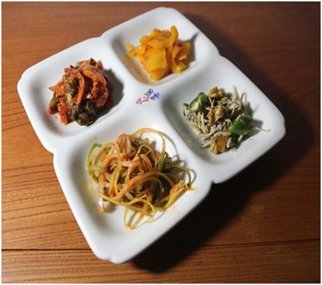 This photo, provided by the local government of North Gyeongsang Province, shows a banchan plate with four sections.