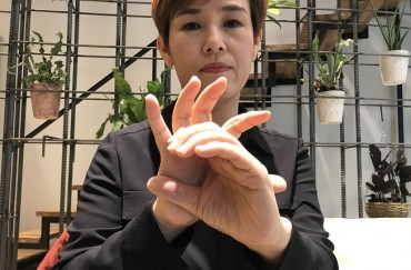 'Pay Attention Not to Us, but to the Deaf': S. Korean COVID-19 Sign Language Interpreter