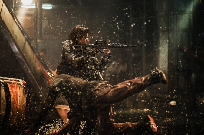 """The still photo provided by NEW on July 11, 2020, shows a scene from the South Korean zombie movie """"Peninsula,"""" starring actors Kang Dong-won and Lee Jung-hyun."""