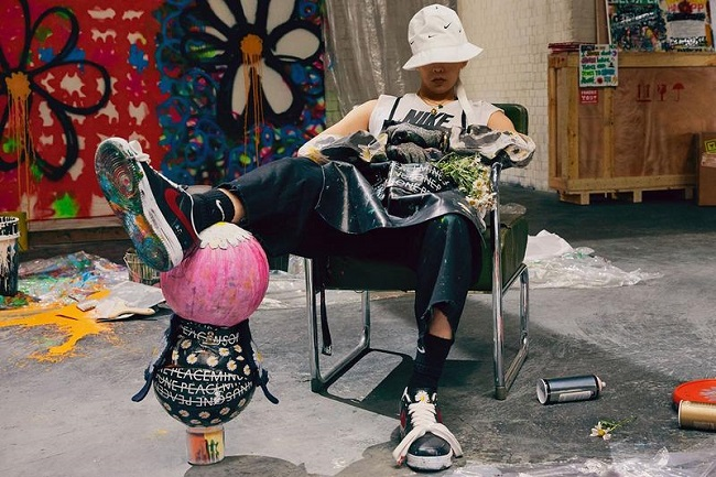 The photo provided by Nike Korea on Nov. 16, 2019, shows G-Dragon, the leader of K-pop boy band BIGBANG wearing a pair of Nike sneakers made in collaboration between the artist and the company.