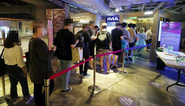 People wait in line to see a movie at CGV Sopoong, the venue of the Bucheon International Fantastic Film Festival, in Bucheon, Gyeonggi Province on July 13, 2020. (Yonhap)