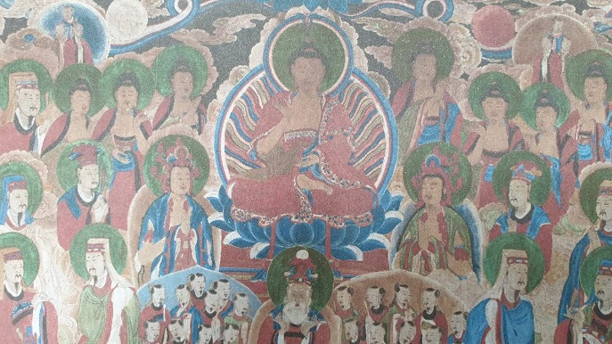 The silk painting, measuring 141 centimeters in width and 102 cm in length, features a radiant seated figure of the Buddha flanked by standing Buddhist saints symbolizing the sun and the moon. (image: Jogye Order of Korean Buddhism)