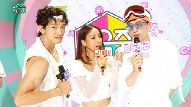 """This image provided by MBC TV shows project K-pop group SSAK3 of the network's weekend variety show """"Hang Out With Yoo"""" appearing on the broadcaster's music program on July 25, 2020."""