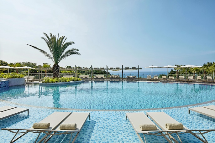 This photo provided by Hotel Shilla shows an outdoor swimming pool at its hotel on Jeju Island.