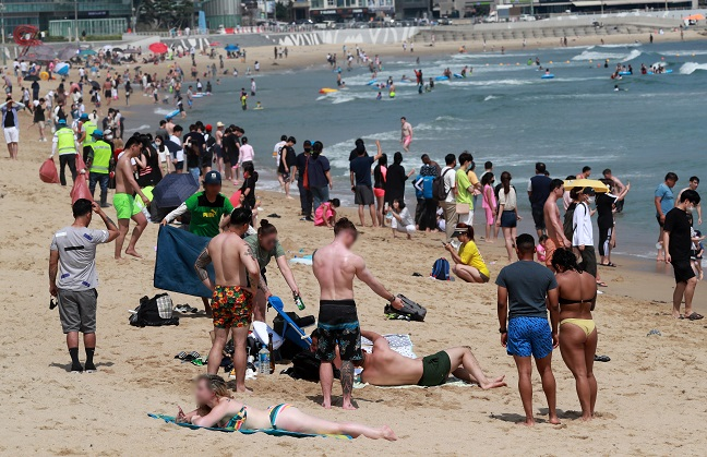 Foreigners enjoy themselves at Haeundae Beach in the southern port city of Busan on July 5, 2020. (Yonhap)