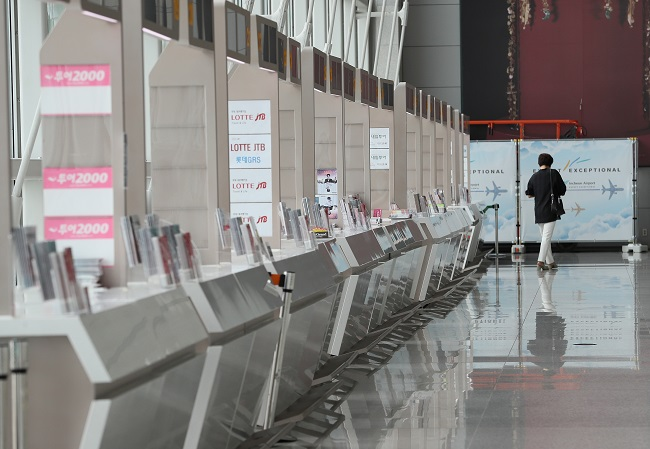 In this file photo, travel agencies' booths are empty at Incheon International Airport, west of Seoul, on July 20, 2020. (Yonhap)