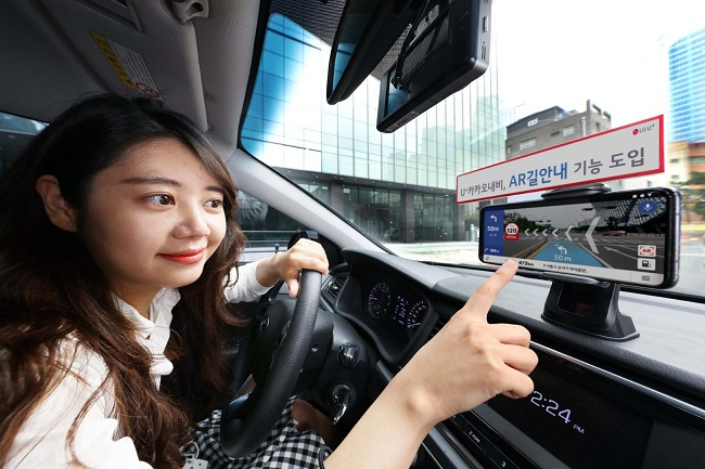 A model showcases LG Uplus Corp.'s new augmented-reality navigation service powered by artificial intelligence technology, in this photo provided by LG Uplus on July 29, 2020.
