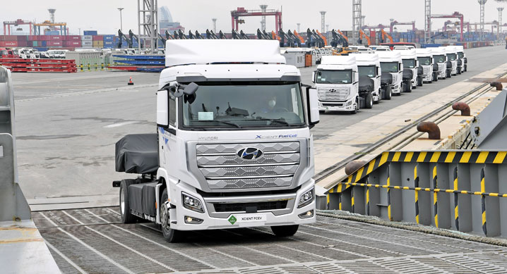 This photo taken July 6, 2020, and provided by Hyundai Motor shows XCIENT Fuel Cell hydrogen trucks being loaded onto the Global Superior roll-on, roll-off ship heading to Switzerland at a port in Gwangyang, 423 kilometers south of Seoul.