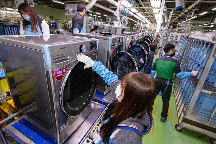 This file photo provided by LG Electronics Inc. on April 10, 2020, shows an LG worker checking clothes dryers at the company's factory in Changwon, South Korea.