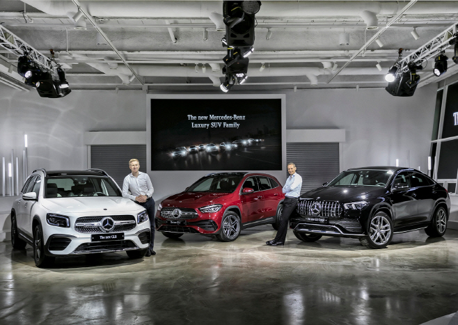 In this photo taken Aug. 27, 2020, and provided by Mercedes-Benz Korea, Mark Raine (R), vice president in charge of product and marketing operations, and Johannes Schoen, director in charge of planning, price and product strategy, stand beside the GLB, GLA and GLE Coupe models (from L to R) at Seoul Wave Art Center in Jamwon, southern Seoul, ahead of an online launching event for the models.