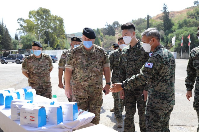 Col. Kim Do-young (R) who commands South Korea's Dongmyung Unit in Lebanon, delivers emergency relief items to Lebanese officers on Aug. 8, 2020, to help the country recover from a recent massive explosion, in this photo provided by South Korea's defense ministry.