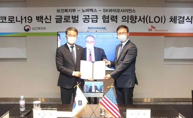 This photo, provided by SK Bioscience Co., a vaccine unit of South Korea's SK Group on Aug. 13, 2020, shows its CEO, Ahn Jae-yong (R), with Health Minister Park Neung-hoo.