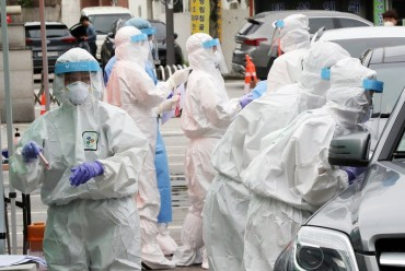 S. Korea's Drive-thru Virus Test Scheme Proposed as Global Standard