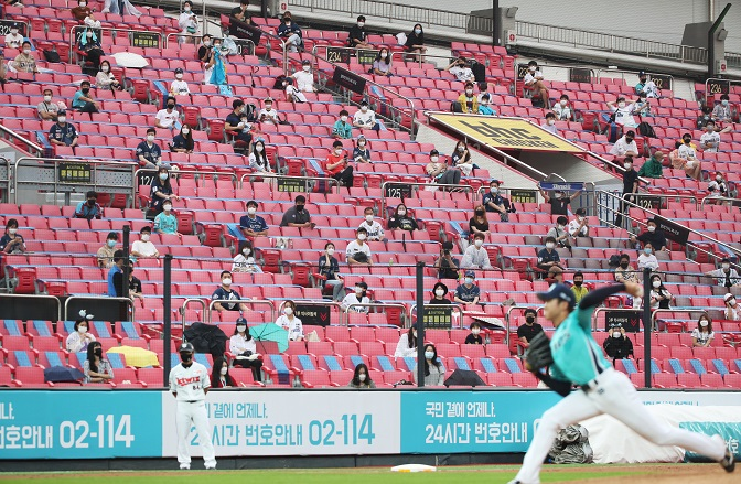 In this file photo taken July 26, 2020, fans are seated at a distance from each other at KT Wiz Park in Suwon, 45 kilometers south of Seoul, during a Korea Baseball Organization match between the KT Wiz and the NC Dinos. (Yonhap)
