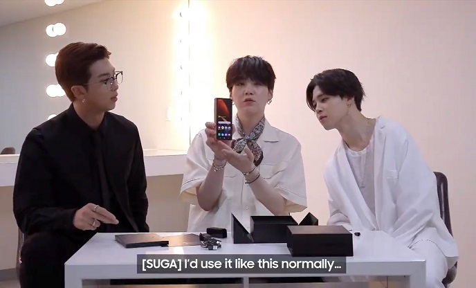 This image captured from Samsung Electronics Co.'s Galaxy Unpacked event on Aug. 5, 2020, shows BTS members introducing the Galaxy Z Fold 2 smartphone.