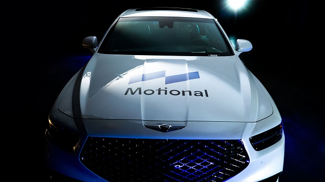This file photo provided by Hyundai Motor shows a G90 flagship sedan with the logo of the Motional brand on it.