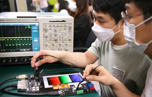 This photo, provided by Samsung Display Co. on Aug. 12, 2020, shows the company's researchers checking on display panel technology.
