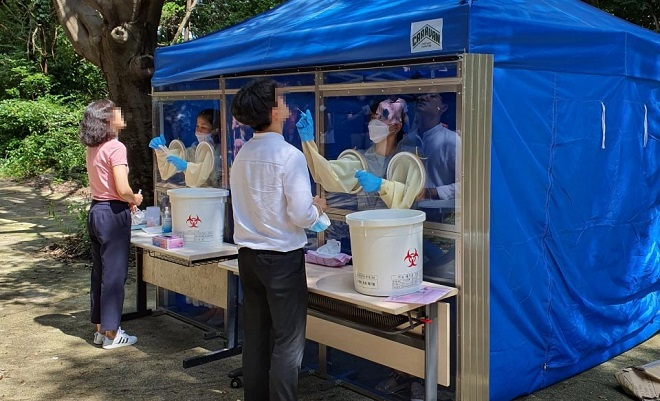 School officials get tested for COVID-19 in Busan on Aug. 13, 2020, in this photo provided by the Haeundae Ward Office.