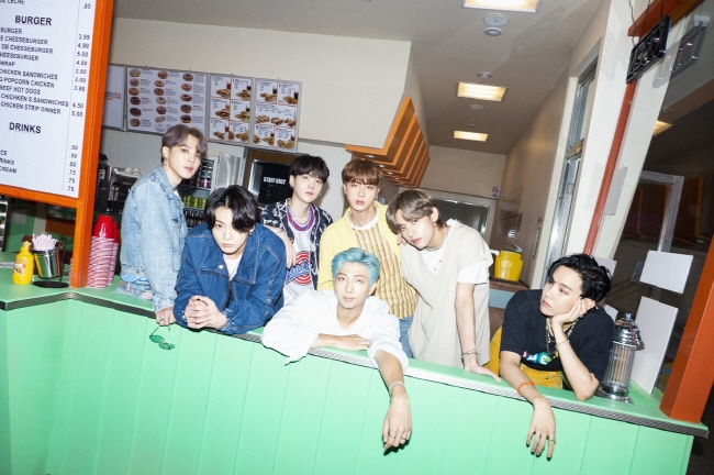 """A publicity photo for """"Dynamite,"""" the latest single album by K-pop giant BTS, provided by Big Hit Entertainment"""