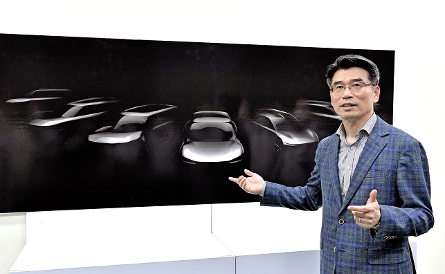 In this photo taken Sept. 16. 2020, and provided by Kia Motors, the company's President Song Ho-sung delivers a briefing on upcoming EV models at its plant in Hwaseong, south of Seoul.