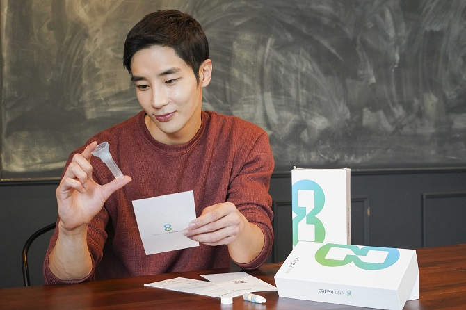 A model showcases the genetic testing kit used in SK Telecom Co.'s health care service care8 DNA, in this photo provided by the company on Sept. 21, 2020.
