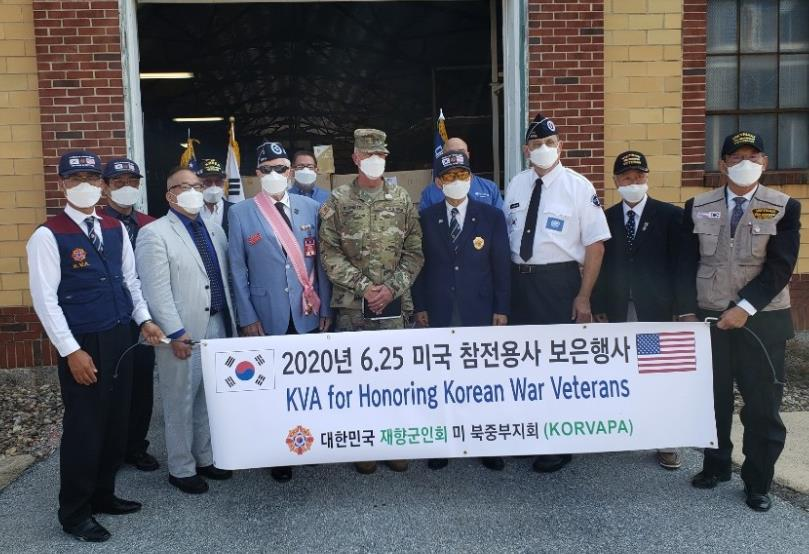 This undated photo, provided by the Korean Veterans Association on Sept. 14, 2020, shows officials from South Korea and the United States posing for a photo during an event to thank Americans who fought in the 1950-53 Korean War.