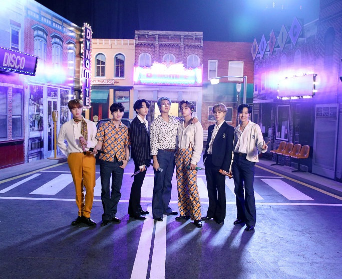 This photo, provided by Big Hit Entertainment on Sept. 19, 2020, shows K-pop group BTS posing for a photo at a set in South Korea where the band filmed a performance for the iHeartRadio Music Festival in the United States.