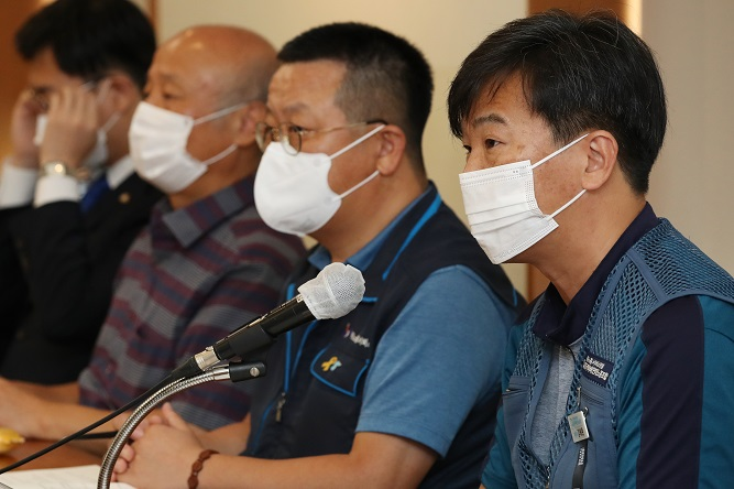 Parcel delivery workers and civic activists speak during a forum on the overwork of courier workers in Seoul on Sept. 10, 2020. (Yonhap)