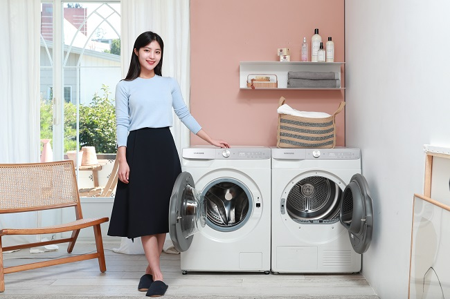 This photo provided by Samsung Electronics Co. on Sept. 16, 2020, shows the company's new Grande AI 10-kg washer and 9-kg dryer.