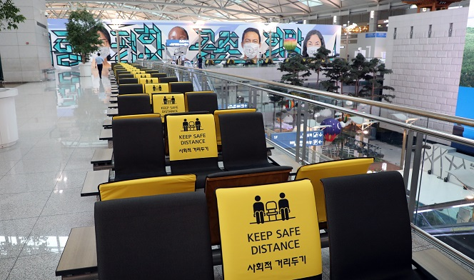 Social distancing signs are attached to chairs at Incheon International Airport, west of Seoul, on Sept. 17, 2020. (Yonhap)