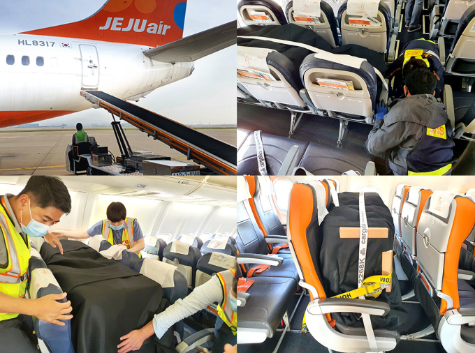 This file photo taken on Oct. 22, 2020, and provided by Jeju Air shows the carrier's employees loading cargo on the seats of a B737-800 passenger jet on the Incheon-Bangkok route at Incheon International Airport in Incheon, just west of Seoul.