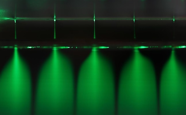 The research team succeeded in mass-producing the ultra-fine water drops by using microelectromechanical system (MEMS) technology to create an ultra-fine nozzle made of polymer that is thinner than a hair. (image: KAIST)