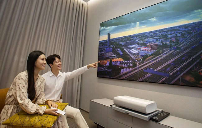 This photo provided by Samsung Electronics Co. on Oct. 5, 2020, shows models promoting Samsung's new home cinema projector, the Premiere.