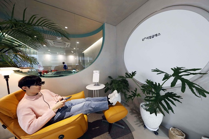 This photo, provided by LG Uplus Corp. on Oct. 15, 2020, shows a model using the carrier's augmented reality glasses at the company's product showroom in southern Seoul.