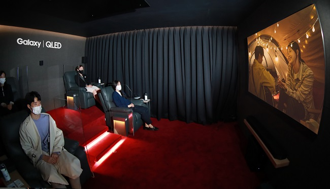 "This photo provided by Samsung Electronics Co. on Oct. 16, 2020, shows people watching the movie ""Untact,"" which was filmed on Samsung's Galaxy smartphones in 8K, at the company's special movie theater in Seoul."